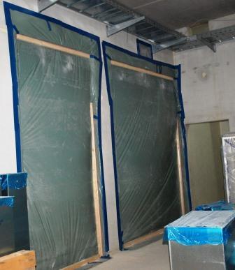 Druckstabile temporäre Abdichtung von 2 großen Durchgängen ca. 3m x 2m in einem Industrieneubau zum in Betrieb befindlichen Bestand.